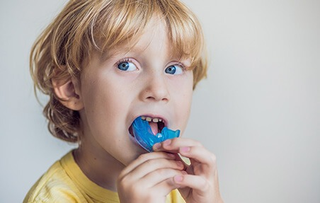 little boy with mouthguard