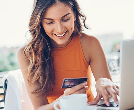 woman paying bill online with credit card