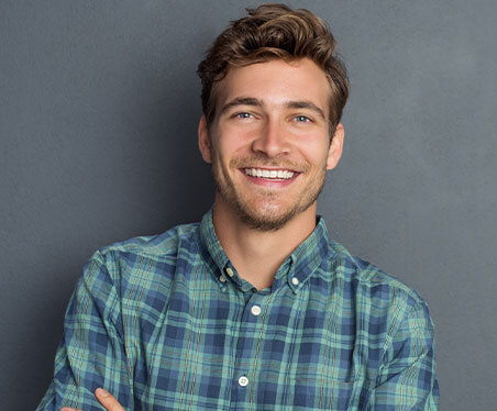 man smiling with straight white teeth