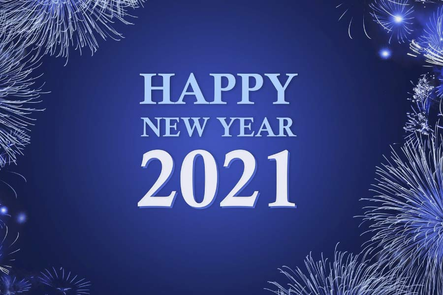 Happy New Year 2021 on a blue background bordered by fireworks.